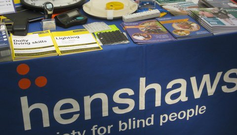 Photo of the table at Henshaws info desk at Manchester Eye Hospital