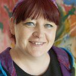 Centre manager Maria Dawbarn in front of a colourful graffiti artwork