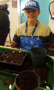 Barnaby preparing pots with compost in horticulture workshop