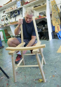 Art maker Andrew putting together a new design for a chair in our woodwork workshop