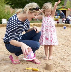 Mum and daughter playing on the urban feva beach making sandcastles