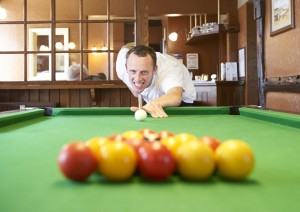 Art Maker Alex playing pool at the local pub during his lunchtime break from the arts & crafts centre cafe workshop
