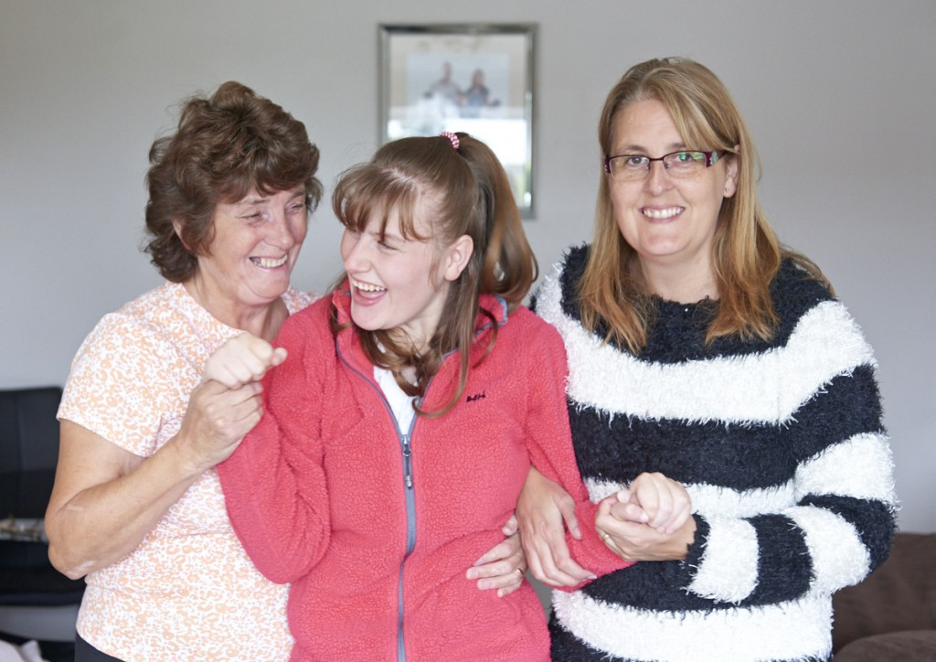 Image of service user Karina with her Mum and a Henshaws carer