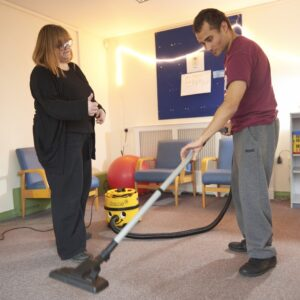 Learning skills for daily living including hoovering in the autism centre
