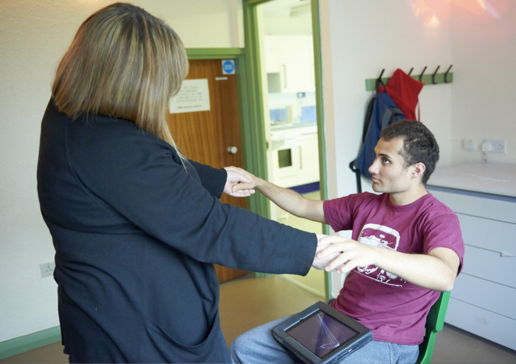 Jamie in a sensory session in the autism centre