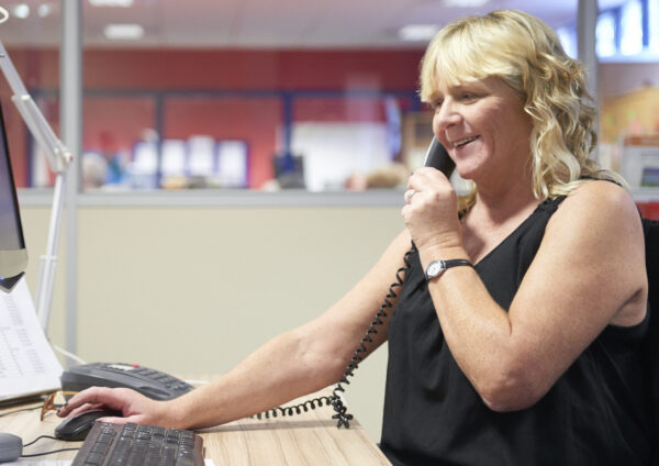 Image of a woman talking on the telephone