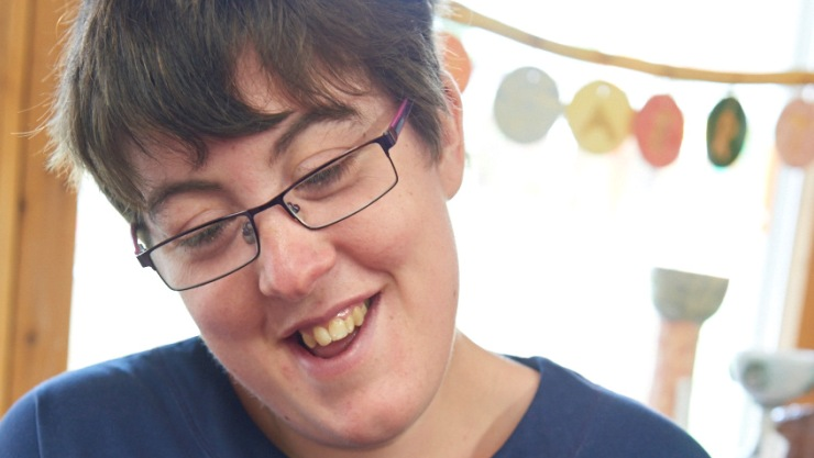 Art maker Sally smiling in our pottery workshop for people with disabilities