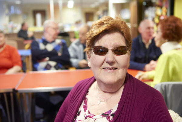 Service user wearing tinted glasses