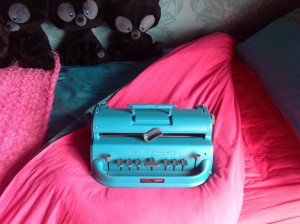 Turquoise brailer on bright pink bedsheet