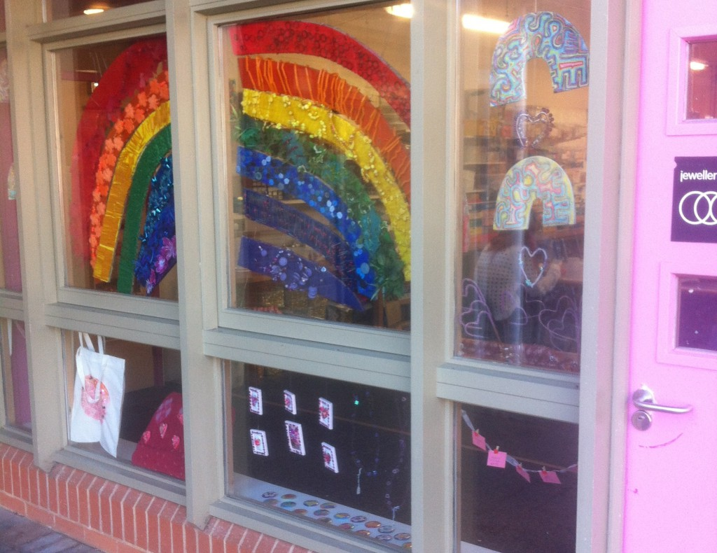 A colourful rainbow hanging in the window of our jewellery creative workshop