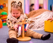 Photo of one of our service users playing in our Manchester hub play area