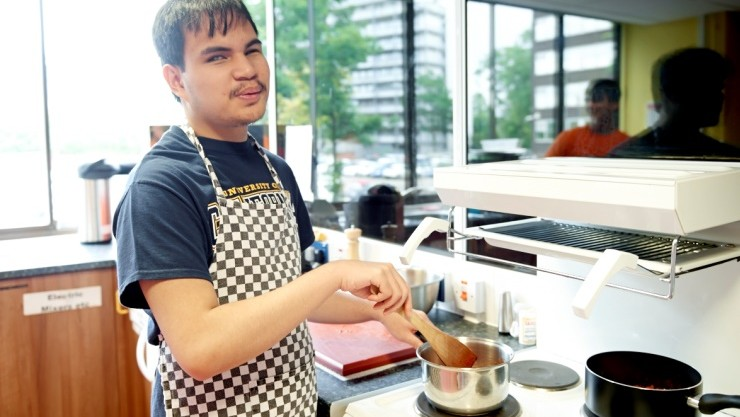 IMCYP student Robin cooking