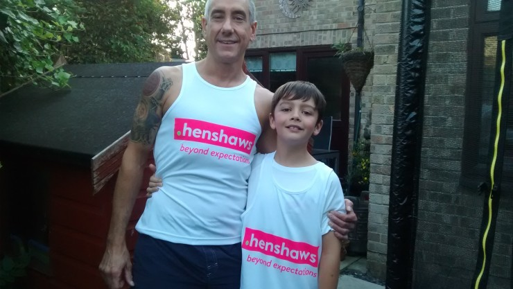 Image of two of our Great North Run 2015 runners David and his son wearing their Henshaws running vests