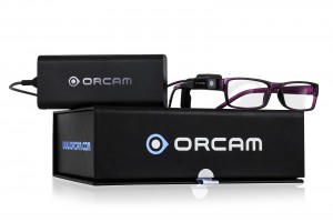 Image of the OrCam glasses sitting on top of the box.