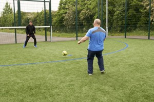 Paul taking a shot with Craig in goal