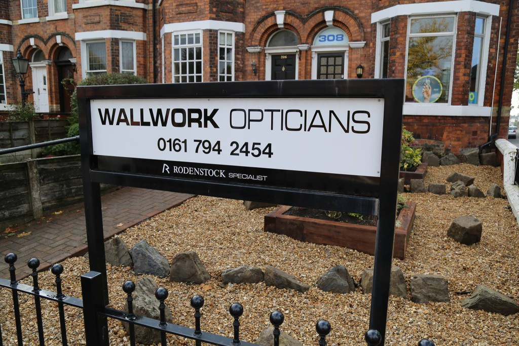 Photo of the sign outside 'Wallwork Opticians' displaying its name