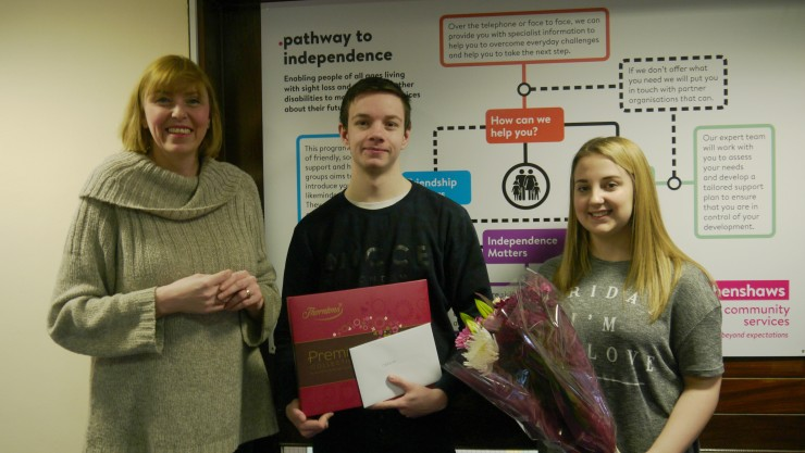 Louise presenting Callum and Charley some choccies, flowers and thank-you cards as part of National Apprentice week.