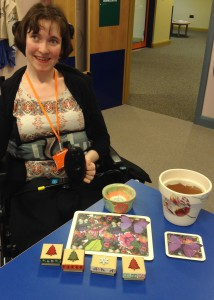 Rachael displaying some of her products including happiness kits, decoupaged flowerpots and table mats