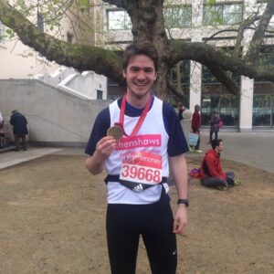 Runner Dan with his medal after running the marathon