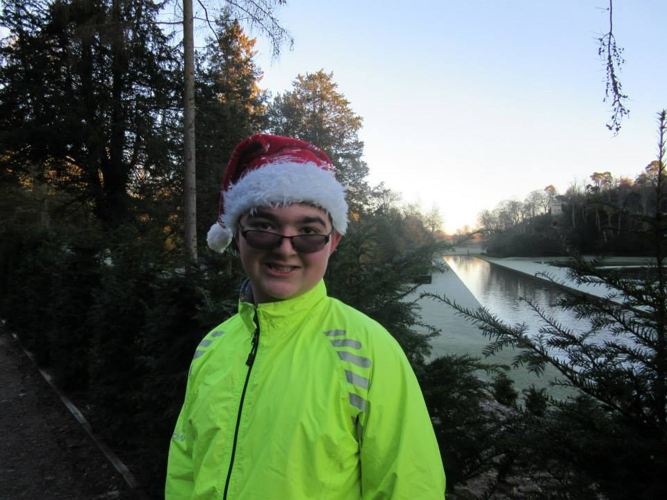 Student Tom in his hi vis jacket and Christmas hat at Fountains abbey parkrun