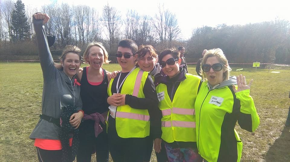 Tom with his mum and group of runners