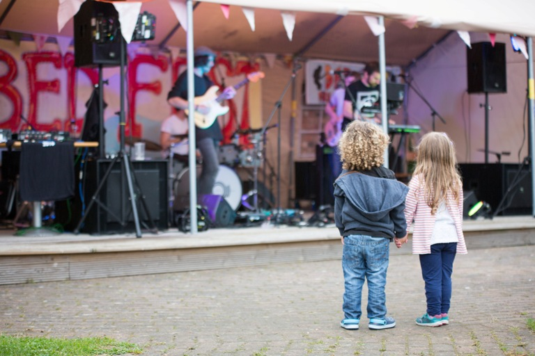 Children dancing in front of the stage at Bed Fest