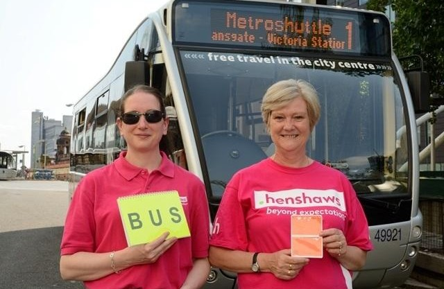Glynis and Gail holding a bus hailer