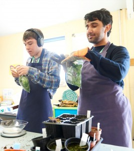 Students packing salad bags to sell as part of a social enterprise on campus