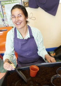 Student filling flowerpots with compost in horticulture