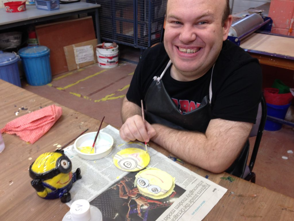 Wesley painting one of his minion coasters