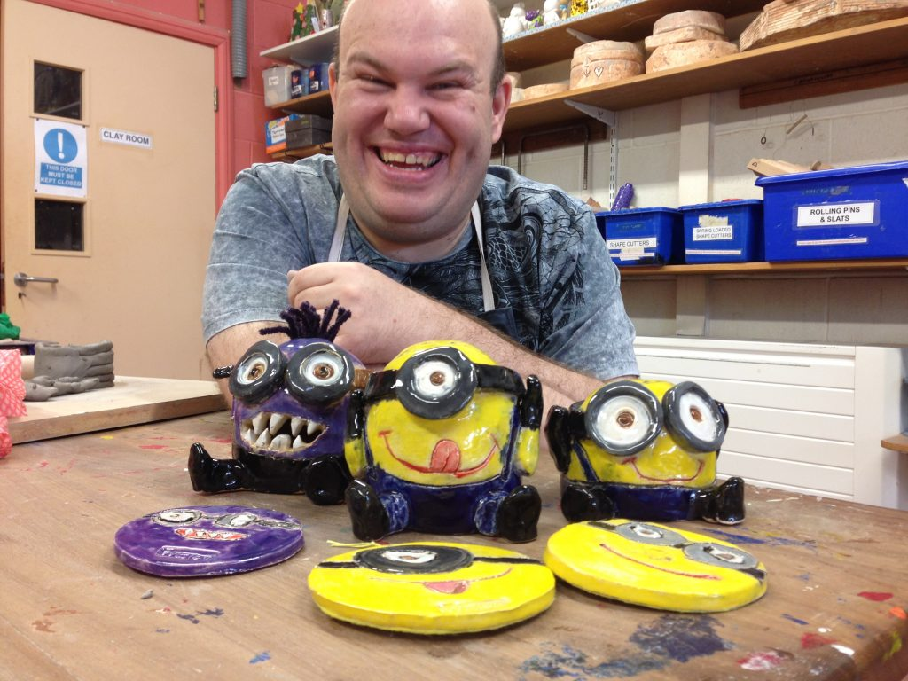 Art Maker Wesley with some of his ceramic minions inspired by Despicable Me