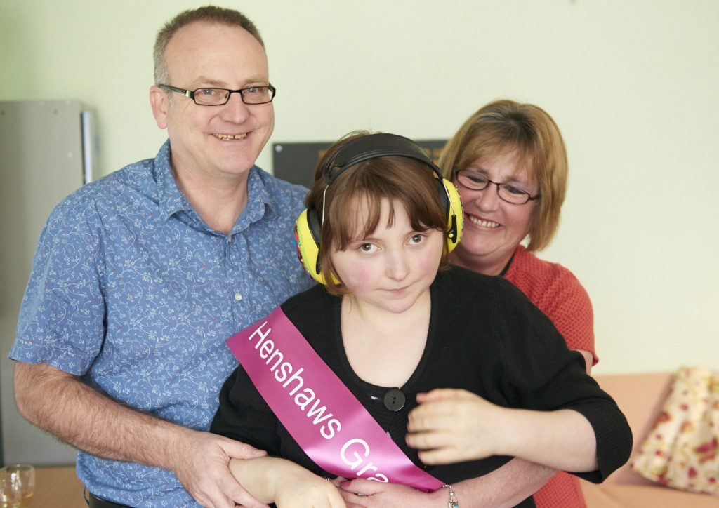 Student Tessa with her family on graduation day