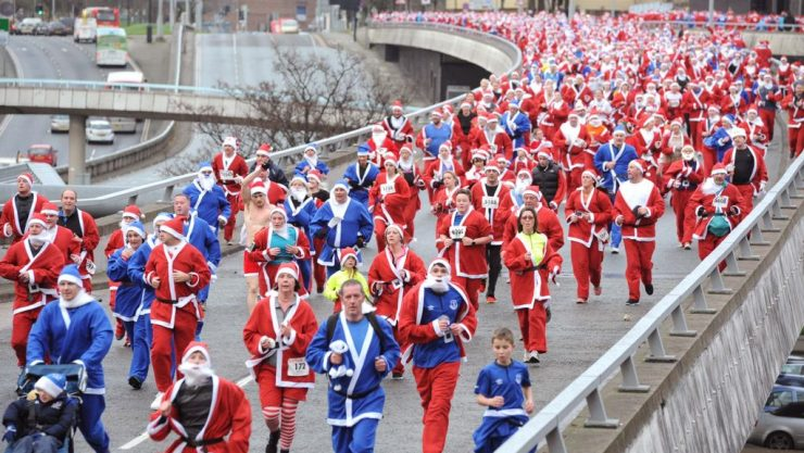 People dressed as Santa running through Liverp