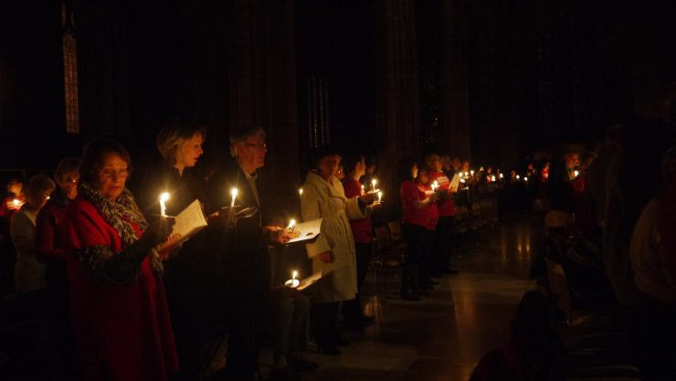 Image of Carols by Candlelight 2015 with candles and singing