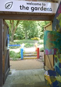 Looking through the gates into our gardens with the ark sculpture in the background