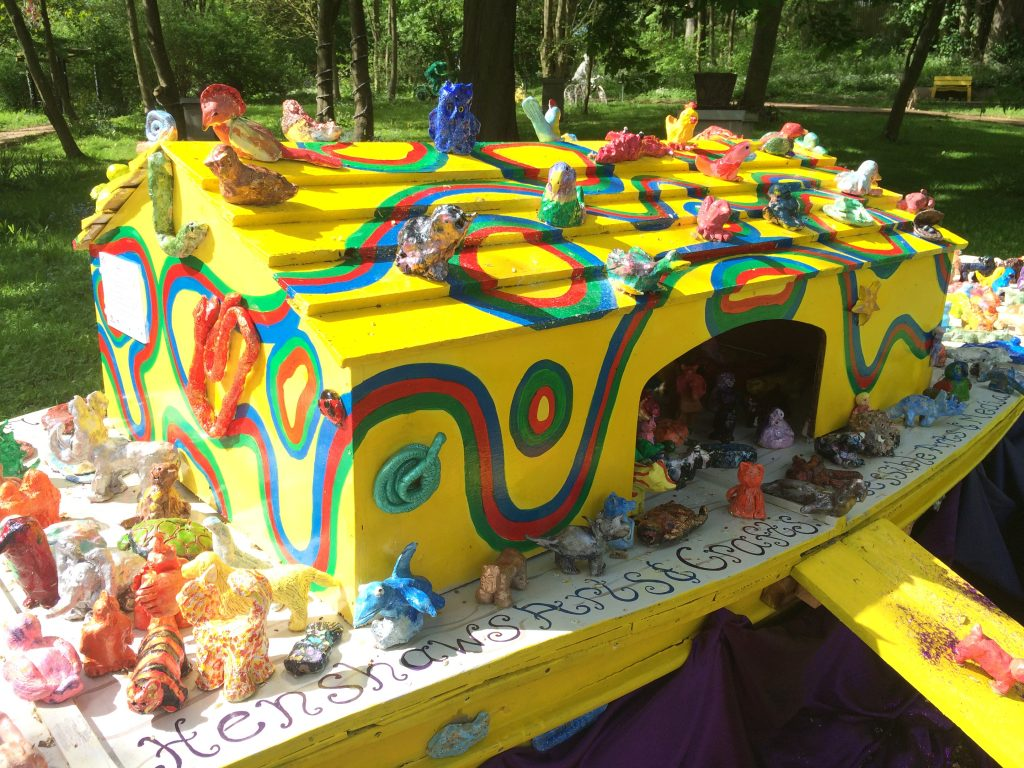 Close up image of Ark sculpture showing the colourful boat with ceramic animal scupltures created by local community groups