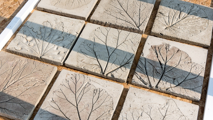 Close-up images of clay tiles pressed with leaf imprints