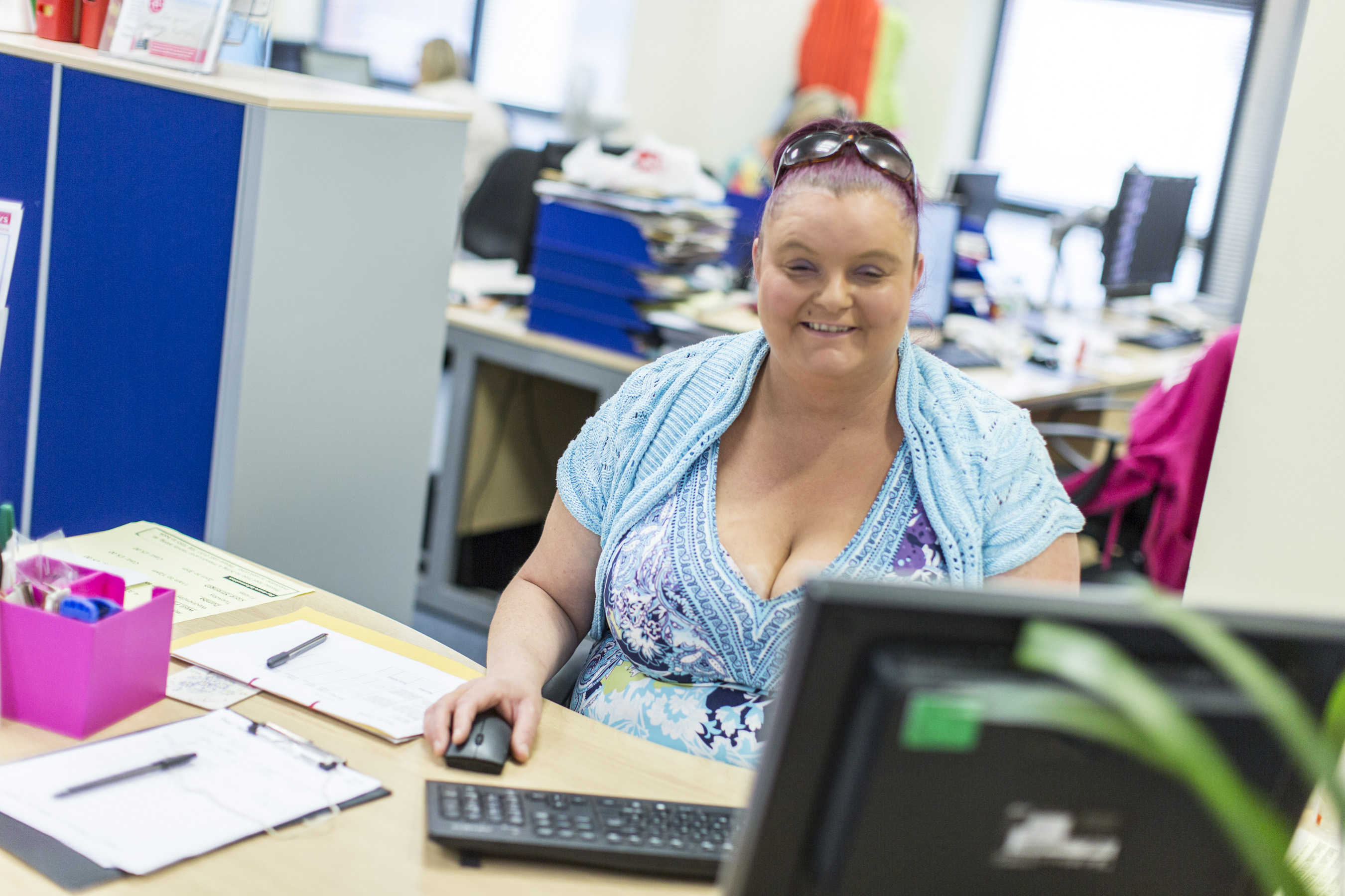 Jo sat at her desk in the Liverpool resource centre, working at the computer