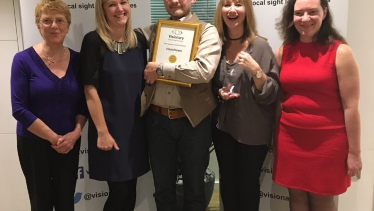 Image of the community services team holding their award