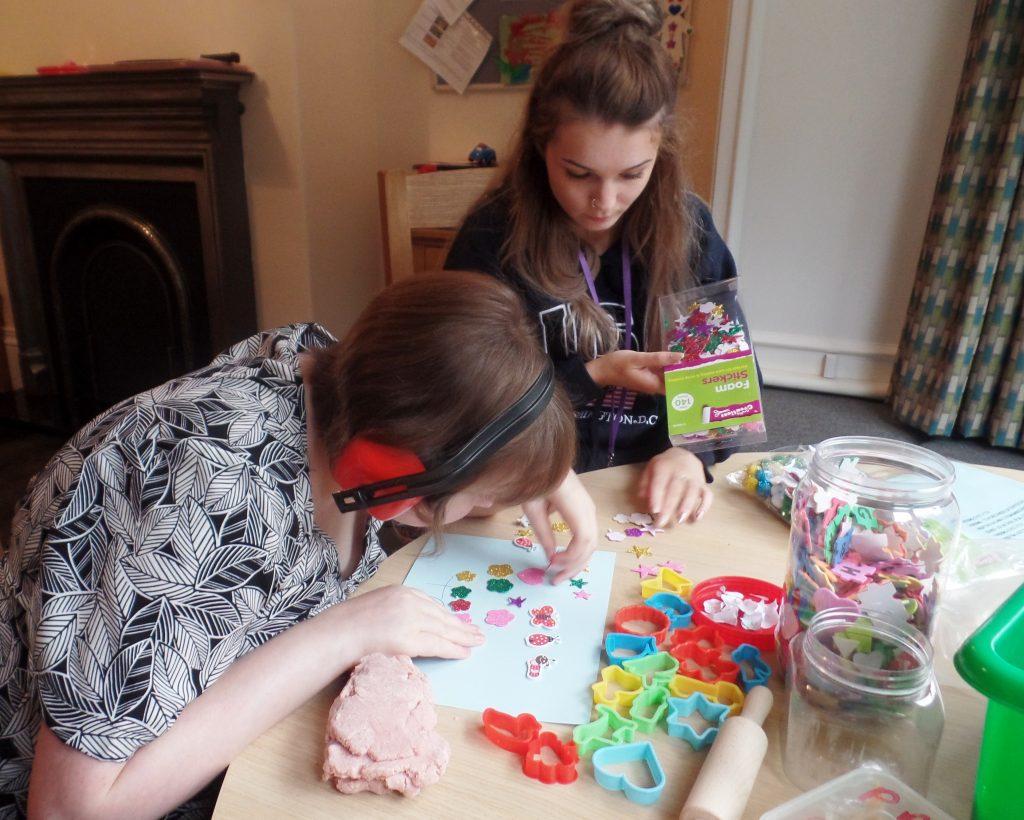 Tessa enjoying craft activities in her new home