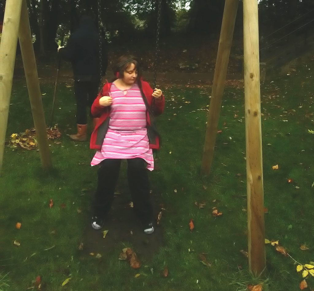 Tessa enjoying the giant wooden swing in the garden at her new home