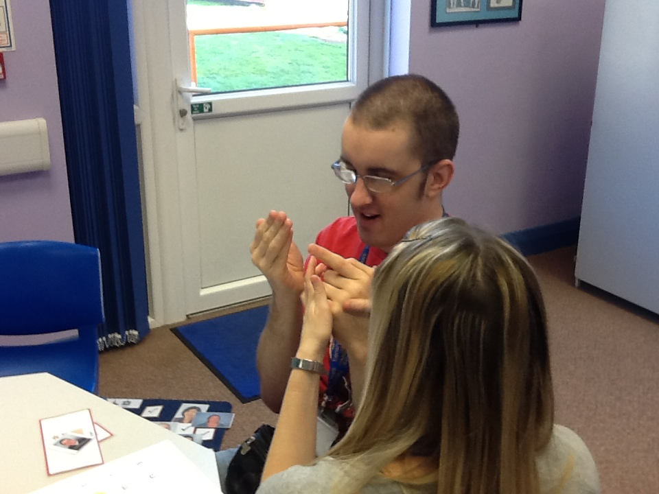 A student being shown a Makaton symbol by an instructor.