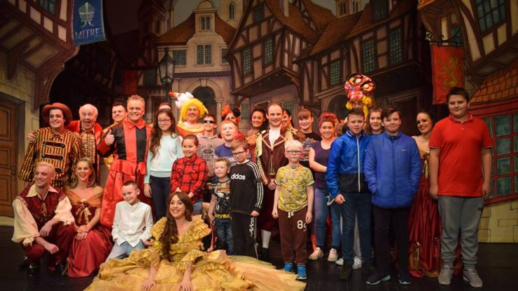 The junior football team and Newcastle members of staff with the panto actors.