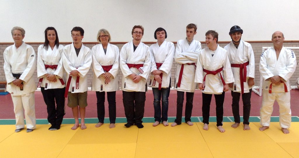 Students from Henshaws Specialist College receiving their red belts in judo