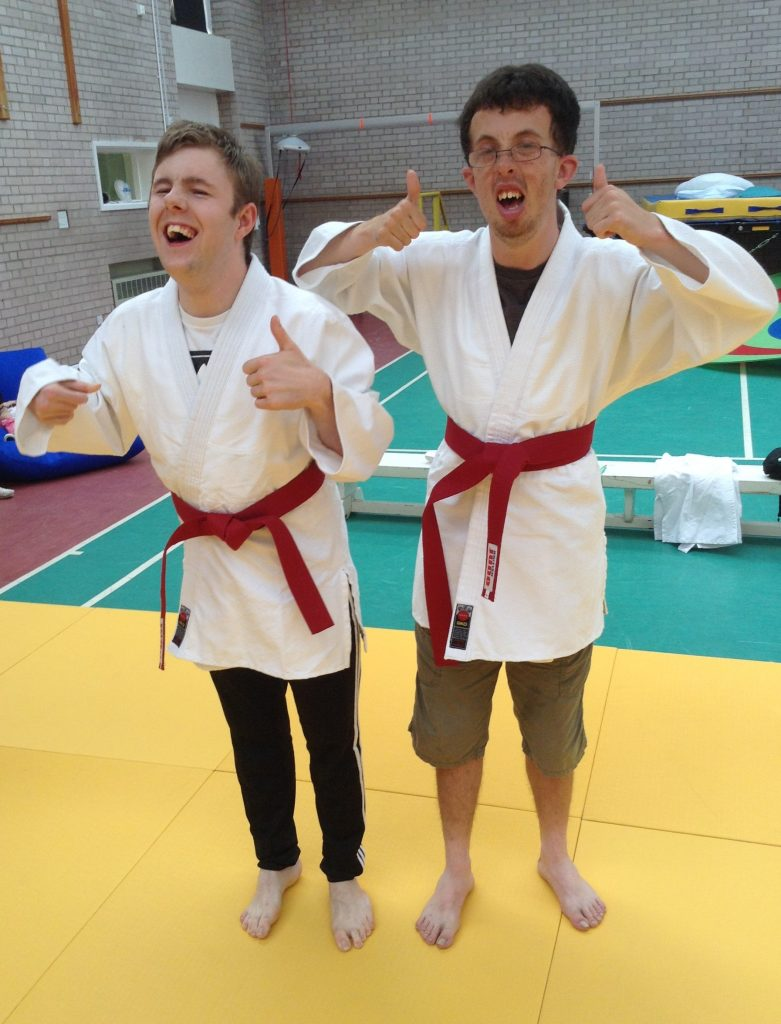 Thumbs up from our students during their disability judo session