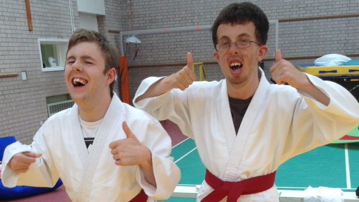 Two students with their thumbs up during judo session - how to make judo accessible for disabled young people