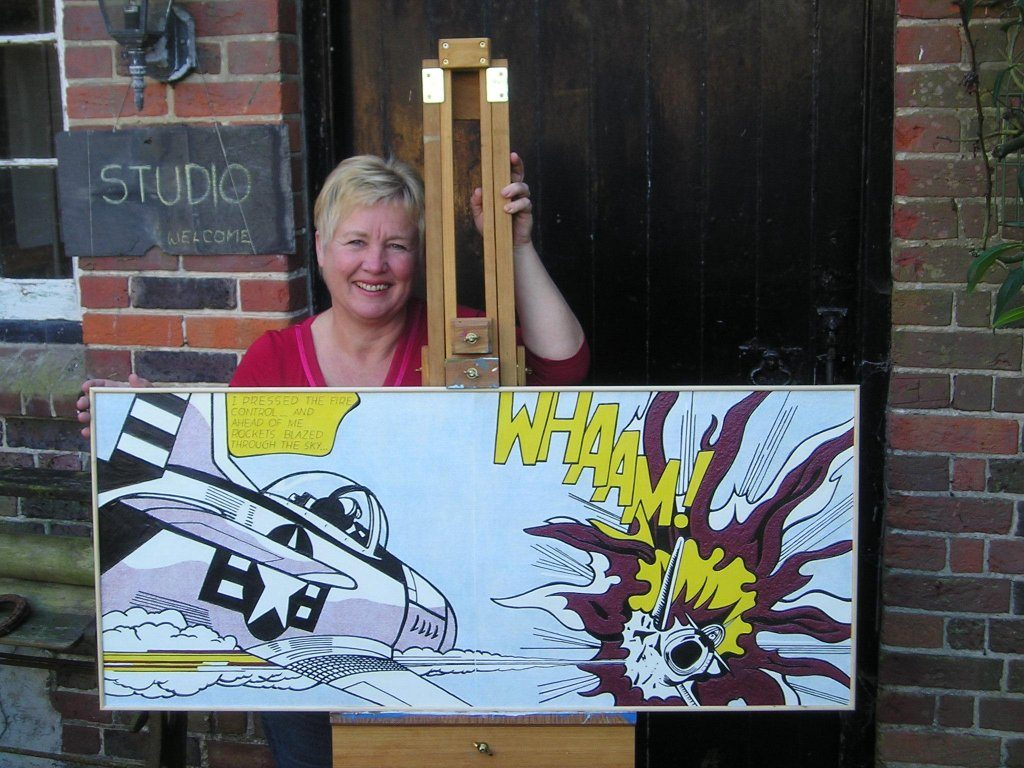 Heather Bowring holding up her tactile version of the painting Whaam!