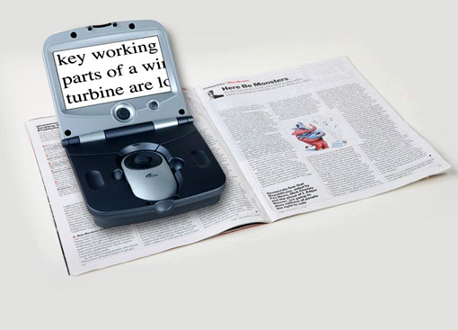 A digital magnifier over a newsletter, showing the text magnified on the screen.