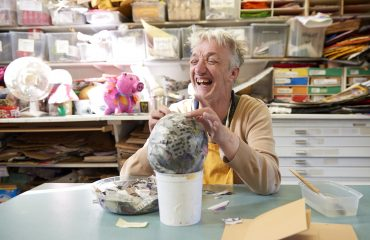 An Art Maker creating a paper mache sculpture in our paper workshop