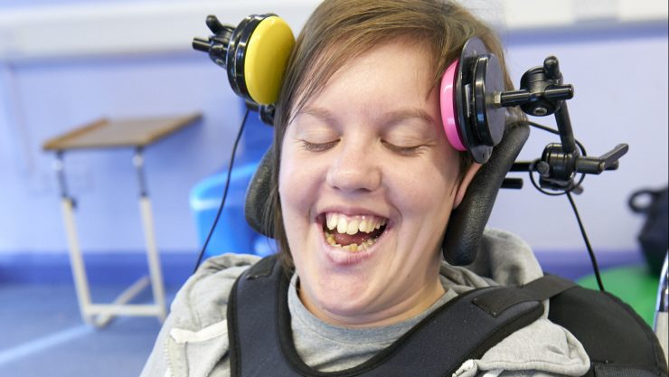 Student Mary using her assistive technology in her music class